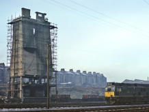 Kittybrester coaling tower in its final stages of demolition, an unidentified D5000, later class 24, looks on, 4 Dec 1965