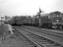 D8028 waits in the Yard while D8029 BLOCKS both roads on the mainline with its train, Huntly, Apr 1961