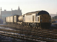 The late afternoon winter sun catches 40022 having a rest on what would have been the tracks for platform 1 or 2 at Elgin, early 1980's.