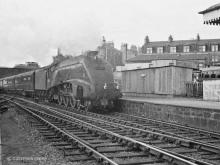 A4 class Miles Beevor brings the postal empties though Kittybrewster Station en route for turning at the shed in 1966