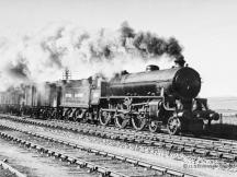 61147 blasts through Kintore on an up fish train 18 June 1949