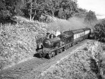 The location is probably approaching Knockando from the east, and the loco a bit blurred, is possibly 62267 in this 1950's Speyside shot.
