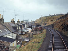 A view from the brake van as the train leaves Banff in April 1968