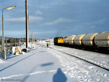 A class 25 with its partner already run round prepares to take liquified gas tanks from Inverurie station back to Port Elphinstone paper mill in this undated winter scene