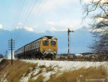 A refurbished class 120 Swindon DMU passes the down distant signal for Inverurie in the winter of 1978