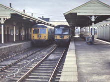 A pair of Cravens units rest at Keith Junction in April 1968, the platform supporting columns were apparently reused after demolition for the present Huntly Station.