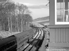 D6156 on the 12.30 Inverness-Aberdeen passes the closed box and yard at Kinaldie, 6 Mar 1963