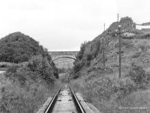 On 11 Aug 1970 these rails with their fishplates already removed would be lifted within hours, the bridge at Satan's Den Lumphanan now is demolished and infilled, the road bend is the key to locating this scene today.