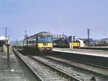 A Cravens DMU on the 12.30 ex Fraserburgh will pick up passengers from the Peterhead service which has terminated at Maud on 1 May 1965, the freight loop on the left unusually has its own platform.