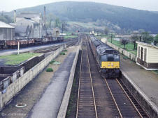 A class 24 arrives at Rothes with a train for Aberdeen in May 1968, note the casks in the distillery sidings,
